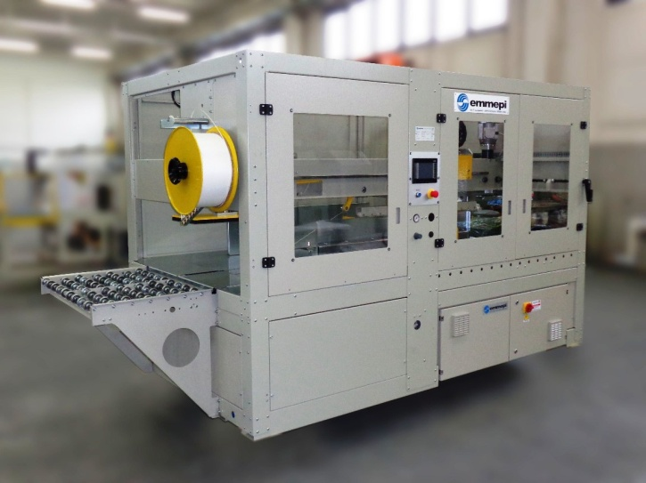 inline-pressing-strapping-machine